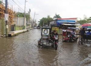 Überflutete Straße in Obando, Metro Manila, Philippinen, Foto: Simon Gehrmann